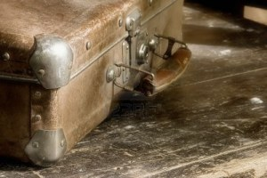 1254658-beloved-grunge-trash-suitcase-on-the-shabby-table
